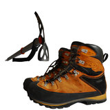 Trekking boots. And ice ax isolated on the white background royalty free stock photos