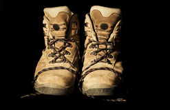 Trekking boots isolated on black stock photos