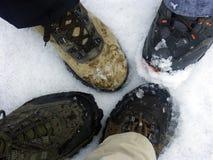 Trekking Boots On Snow Floor Royalty Free Stock Photos
