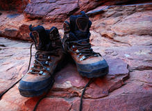 Trekking boots on red rocks Stock Image