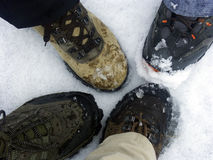 Trekking boots on snow floor. To illustrate teamwork Royalty Free Stock Photos