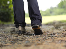 Trekking boots walking away Royalty Free Stock Images