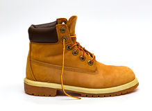Trekking boots. Yellow leather trekking boots  on a white Stock Photo