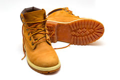 Trekking boots. Yellow leather trekking boots  on a white Stock Images