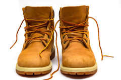 Trekking boots. Yellow leather trekking boots  on a white Royalty Free Stock Photography