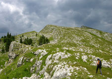Trekking in Buila. Summer day in Buila mountains (a ridge of limestone in Carpathians Royalty Free Stock Photos