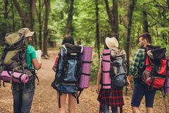 Trekking, camping, harmony, peace concept. Rear view of two couples stock photo