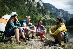 Trekking, camping, hiking and wild life concept. Group of friends are hiking in nature. Trekking, camping and wild life concept. Best friends are hiking in stock photo