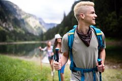 Trekking, camping, hiking and wild life concept. Group of friends are hiking in nature. Trekking, camping and wild life concept. Best friends are hiking in stock photography