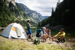 Trekking, camping, hiking and wild life concept. Group of friends are hiking in nature. Trekking, camping and wild life concept. Best friends are hiking in stock photos