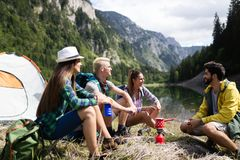 Trekking, camping, hiking and wild life concept. Group of friends are hiking in nature royalty free stock photography