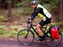 Trekking cyclist. A trekking cyclist on the road Stock Photos