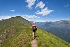 Trekking in den Alpen Stockbild