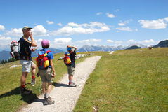 Trekking in Dolomites. Father with his two kids trekking in Dolomites/Italy Royalty Free Stock Images