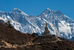 Trekking in Everest region, Nepal. Buddhist stupa with Lhotse wall and Mt. Everest in background, Nepal Royalty Free Stock Images