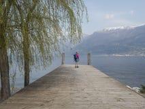 Trekking on garda lake. Mountains nature e landscape from the pier stock photo