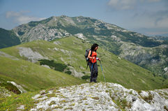 Trekking girl in the mountains Royalty Free Stock Images