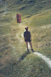 Trekking girl on a mysterious trail Royalty Free Stock Photography