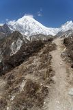 Mountain landscape in Nepal. Trekking in Himalaya mountains with snow peaks Stock Photos