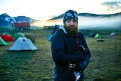 Trekking in Iceland. Beautifull camping with tents near mountain lake. Travel to Iceland. Beautiful sunrise in camping near Alftavatn lake. Icelandic landscape Stock Image