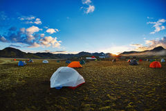 Trekking in Iceland. camping with tents near mountain lake Royalty Free Stock Images