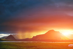 Trekking in Iceland. camping with tents near mountain lake Stock Photo
