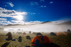 Trekking in Iceland. camping with tents near mountain lake. Travel to Iceland. Beautiful Icelandic landscape with mountains, sky and clouds. Trekking in national Royalty Free Stock Photo