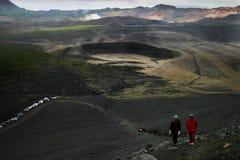 Trekking on Icelandic vulcanos. Some people climbing on icelandic volcanos in the Myvatn region Stock Photography