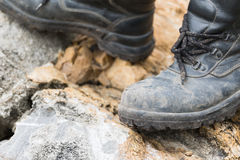 Trekking leather boot on the rock Royalty Free Stock Photography