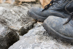 Trekking leather boot on the rock Royalty Free Stock Photos