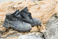 Trekking leather boot on the rock Royalty Free Stock Image