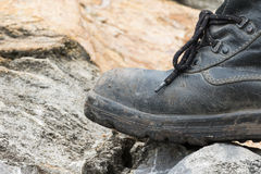 Trekking leather boot on the rock Stock Images
