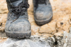 Trekking leather boot on the rock Royalty Free Stock Images