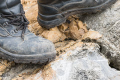 Trekking leather boot on the rock Stock Photo