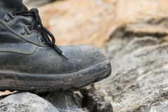 Trekking leather boot on the rock Stock Image