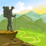 Trekking man with a backpack in the mountains Stock Photo