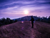 Trekking moment at the top of the hill Royalty Free Stock Image