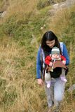 Trekking mother with baby Stock Photography