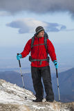 Trekking in mountains. Trekking in Carpathian mountains (Romania) in winter time with professional equipment and big backpack Stock Photo