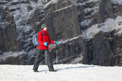 Trekking in mountains. Trekking in Carpathian mountains (Romania) in winter time with professional equipment and big backpack Stock Images