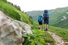 Trekking in mountains royalty free stock images