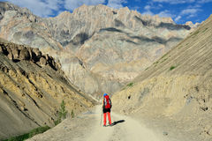Trekking in the mountains Karakorum near the Indian Ladakh town. Tourist during expedition in the mountains Ladakh is admiring the beautiful Karakorum panorama Stock Image