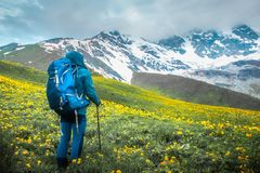 Trekking in mountains stock photo