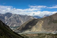 A woman`s face on the mountain in Nagar Valley Pakistan Royalty Free Stock Photo
