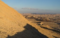 Trekking in Negev dramatic stone desert, Israel. View of ramon crater desert of southern israel during hiking Royalty Free Stock Images
