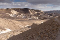 Trekking in Negev dramatic stone desert, Israel. View of ramon crater desert of southern israel during hiking Stock Images