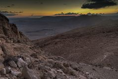 Trekking in Negev dramatic stone desert, Israel. View of ramon crater desert of southern israel during hiking Stock Photo
