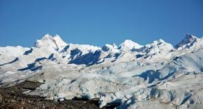 Trekking over Perito Moreno Stock Photography