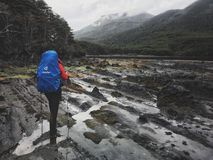 Trekking in Patagonia. Backpacker in a mountain terrain. Punta Arenas. Cape Froward Stock Photos