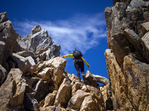 Trekking in Patagonia. Woman with backpack climbing the rocks of Cerro Catedral - Bariloche - Patagonia - Argentina Stock Photos